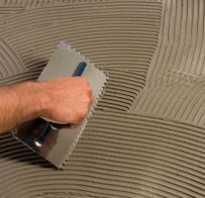 Как выровнять пол плиточным клеем