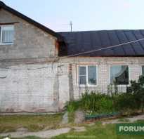 Отделка фасада каменного дома бетонной плиткой «под кирпич»